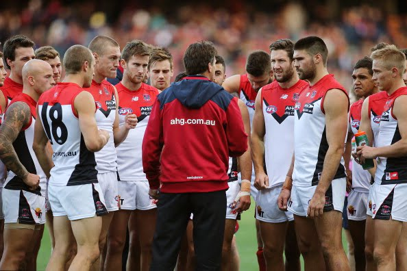 ADELAIDE, AUSTRALIA - MAY 03: Paul Roos of the Demons speaks to his team during the round seven AFL match between the Adelaide Crows and the Melbourne Demons at Adelaide Oval on May 3, 2014 in Adelaide, Australia.  (Photo by Morne de Klerk/Getty Images)