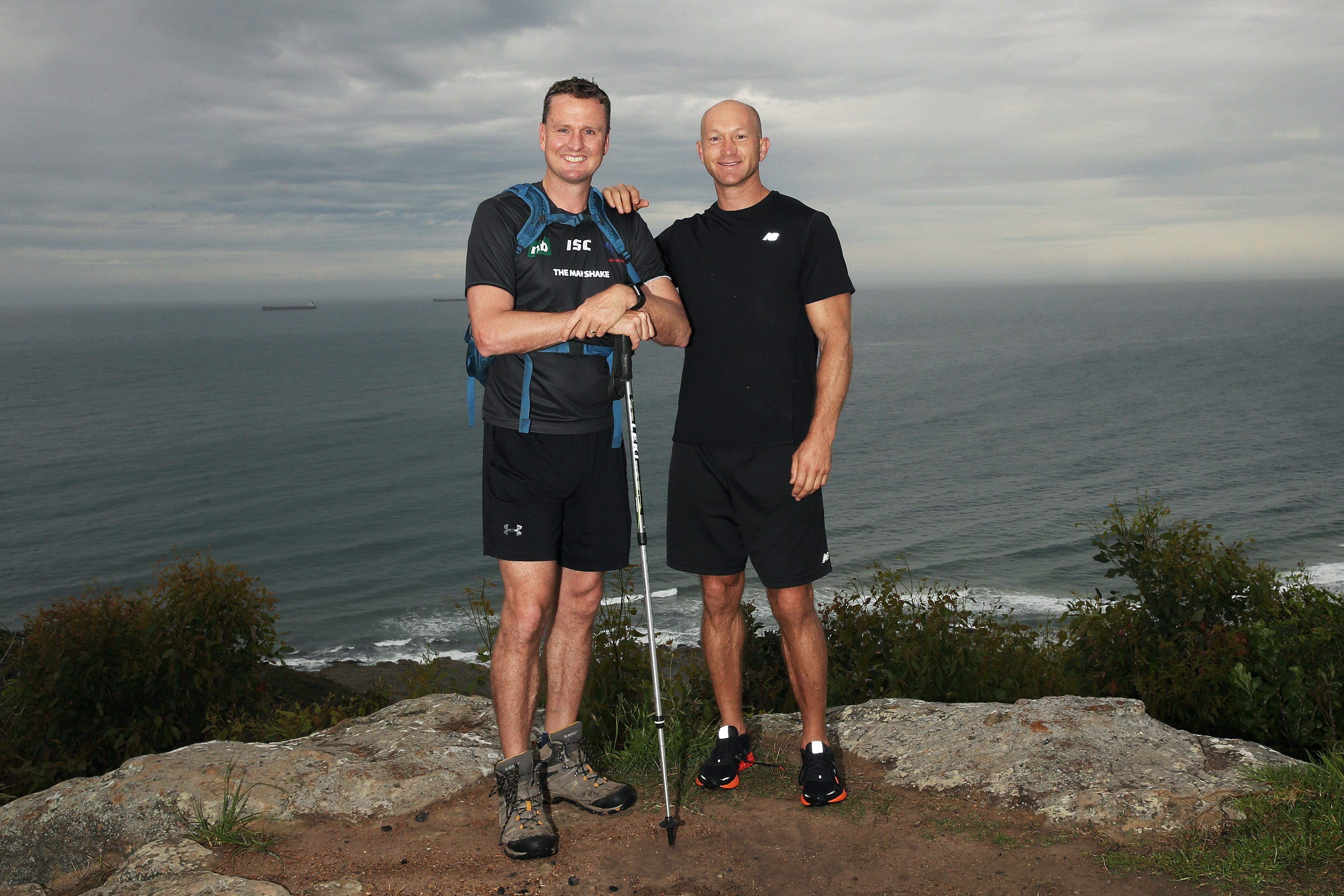 Mark Hughes discussing his training program with former Knight's team mate and MadFit's Adam McDougall before his trek to raise money for brain cancer in Borneo. Picture by Peter Lorimer.